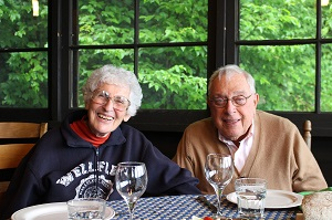Joan and Joseph Birman, smiling at dinner