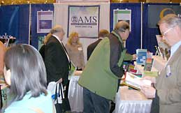 Annette talks with visitors to the AMS booth