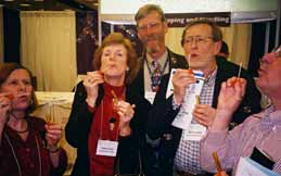 Norman Richert et al in the Matheamtical Reviews area of the AMS exhibit