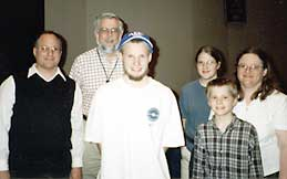 Arthur and his family and teacher Dick Olson (in back)
