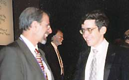 Noam Elkies (right), congratulated by AMS President Eisenbud