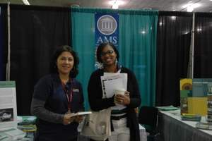 Students in the AMS booth at SACNAS 2011