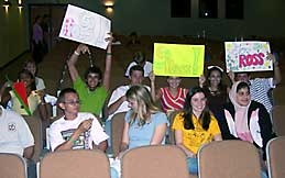 Audience members root for contestants
