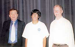 Grand prize winner Abhi Gulati with teacher Ron Vavrinek and game host Mike Breen