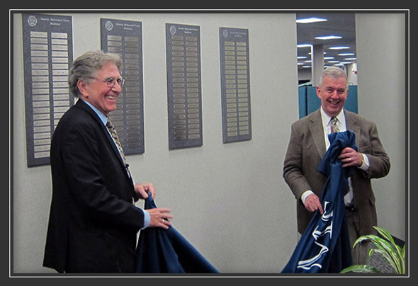 Ron Stern and Donald McClure of the AMS rededicate donor wall