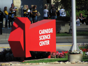Carnegie Science Center arrow