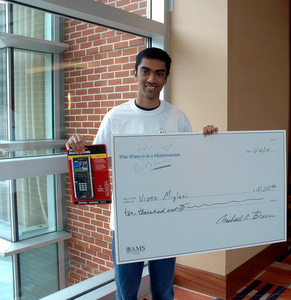 Vivek with his check