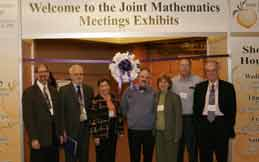 AMS President David Eisenbud, AMS Executive Director John Ewing,  MAA Secretary Martha Siegel, MAA Associate Secretary Jim Tattersall, MAA Executive Director Tina Straley, MAA President Ron Graham and AMS President-Elect James Arthur at the JMM Exhibits Grand Opening