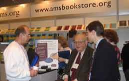 Benoit Mandelbrot signs books at the AMS exhibit
