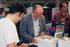 Donald Saari signs his book at the AMS exhibit