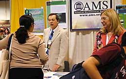 Ellen Maycock and Mike Breen in the AMS booth